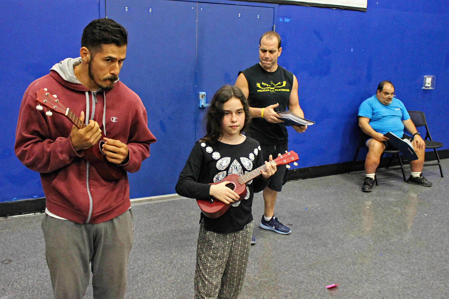 Actors with ukuleles practicing scene during Twelfth Night rehearsal